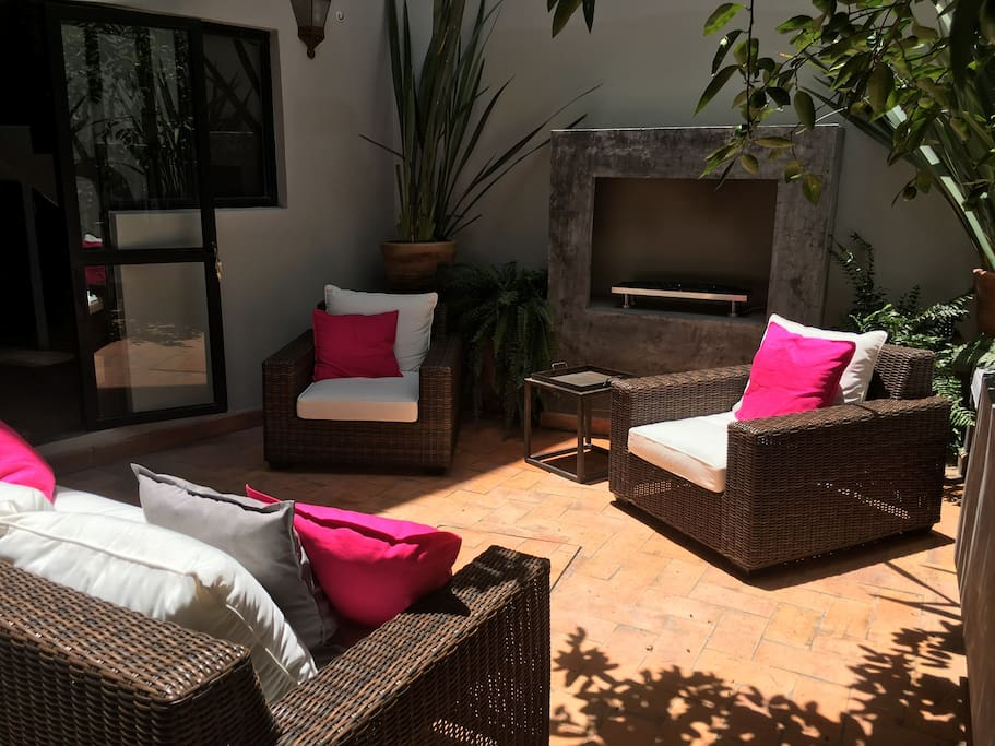 Courtyard sitting area with outdoor gas fireplace.