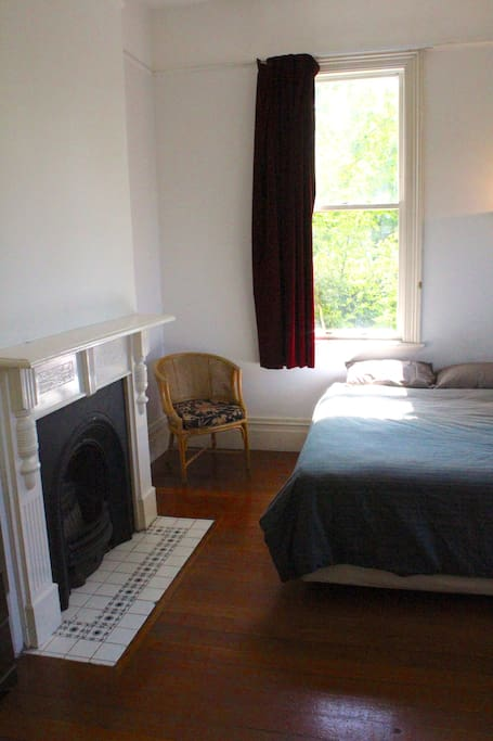 Your room is one of the nicest in the house, featuring a queen bed and grand old fireplace (not in use)