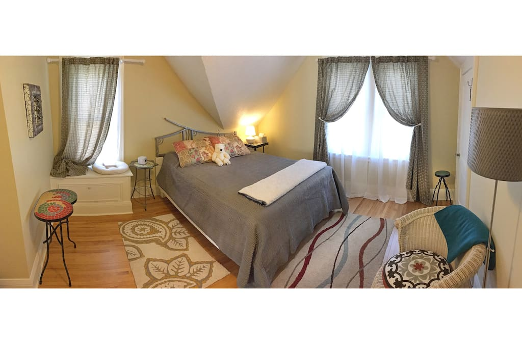 The north bedroom's queen bed and custom furnishings will provide a great night's sleep.