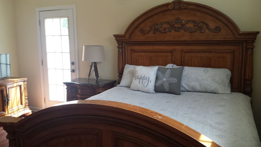 King Master Bed on 1st floor has private patio.