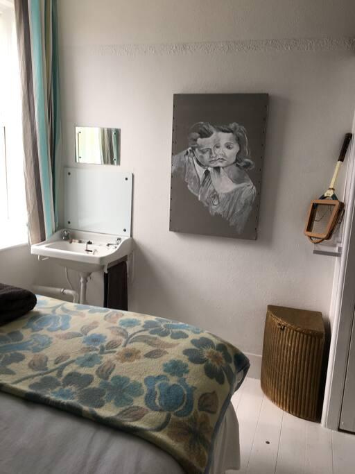 Edwardian sink, mirror, Lloyd Loom linen basket, original painting by Hedley Roberts.