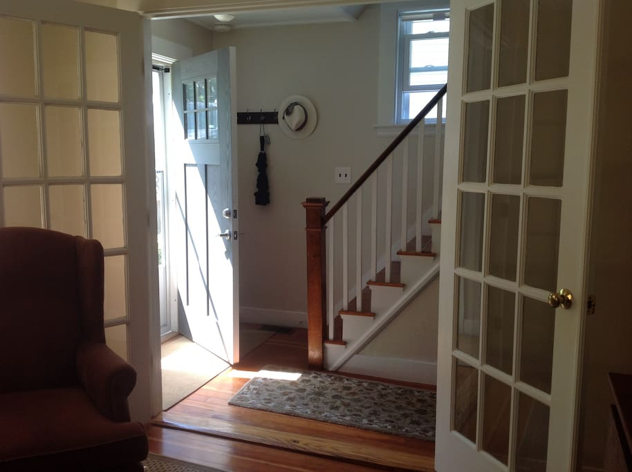 Front entry with French door to living room and stairs to second floor