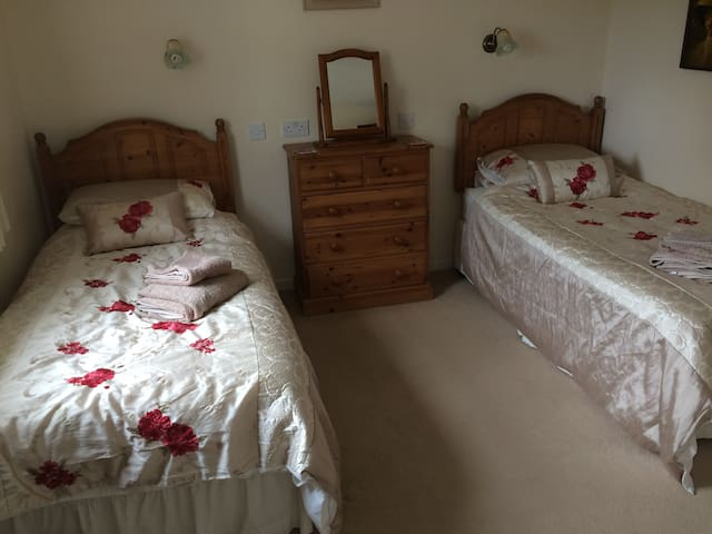 Bedroom with two single 3ft beds