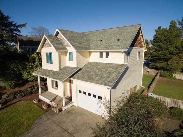Stay 2 blocks from the beach in this 4 bedroom moments from downtown Seaside!