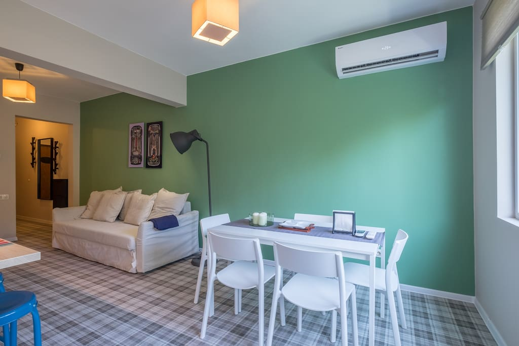 Dining area. Up on the wall is Air Conditioner.