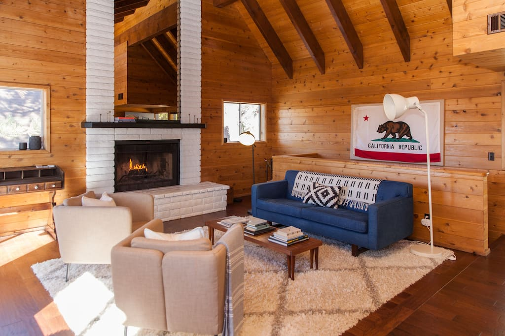 The living room has an oversized fireplace for cozy days and nights.