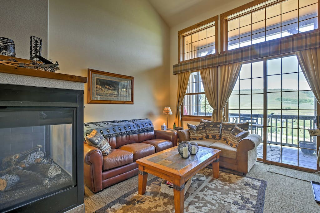 Enjoy sweeping mountain and landscape views through the living room's windows.