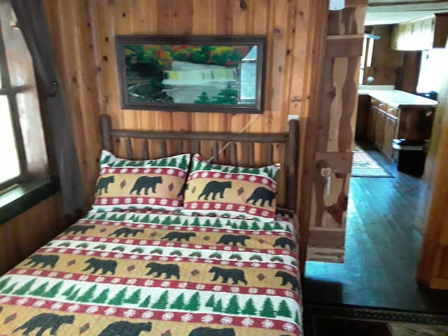 New hickory bed frames with new bear comforters and sheets.