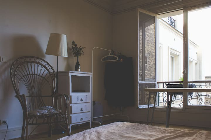 Spacious bedroom in a typical Parisian apartment