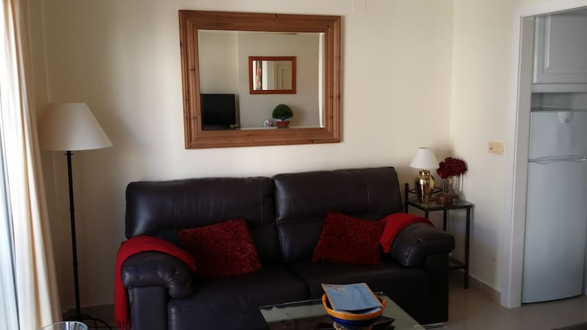 Living room containing comfortable leather sofa and armchair