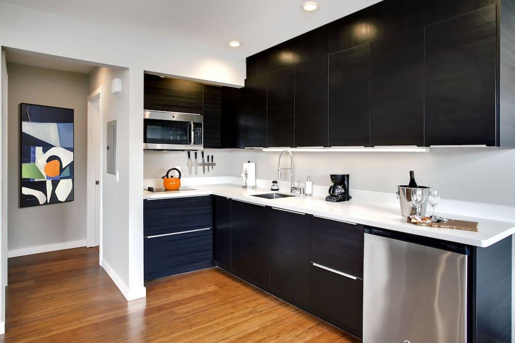 Modern kitchen with dishwasher, fridge