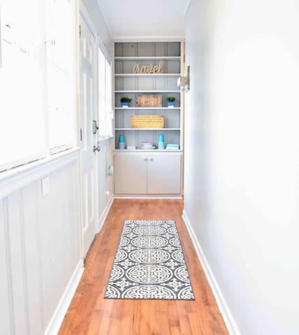 Long hallway separates the two bedrooms for additional privacy.