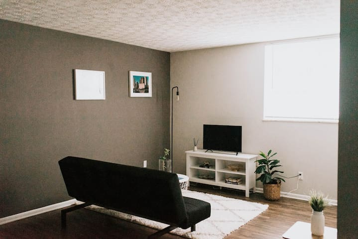 Sleek, modern design with cozy accents, like the plush rug and potted plant, make the living room an excellent place to hang out, do some work on your laptop, or watch some TV.