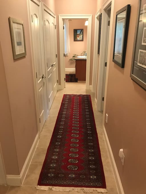 The guest bedrooms are off their own separate hallway; this section of the house has its own full bath and half bath.