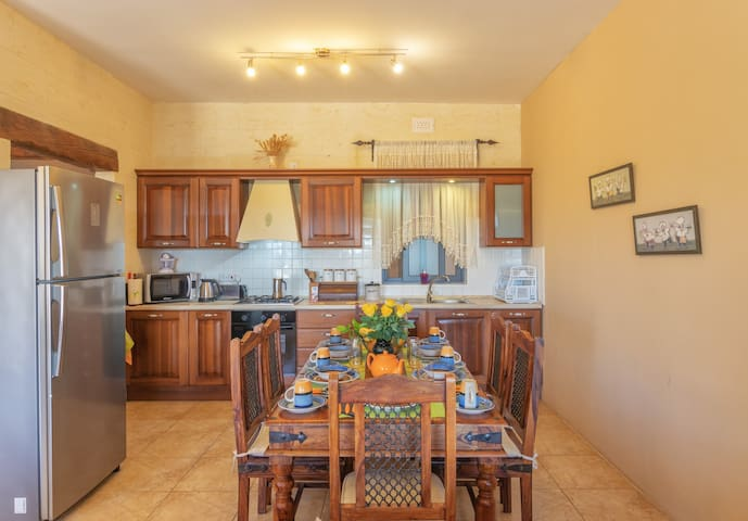 Kitchen with Cooking and Dinning Facilities