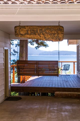 Swing your vacation away on this large wooden swing just at the entrance to the deck.