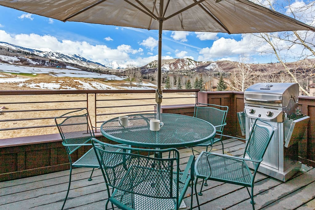 A private deck with seating for 4 and a gas grill; enjoy stunning views towards Mount Daly.