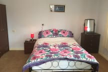 Bedroom 3 with double bed and ensuite bathroom with shower.