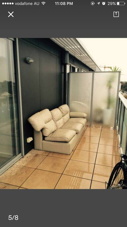 2 balcony both with comfy couches both with great views of the city and sea