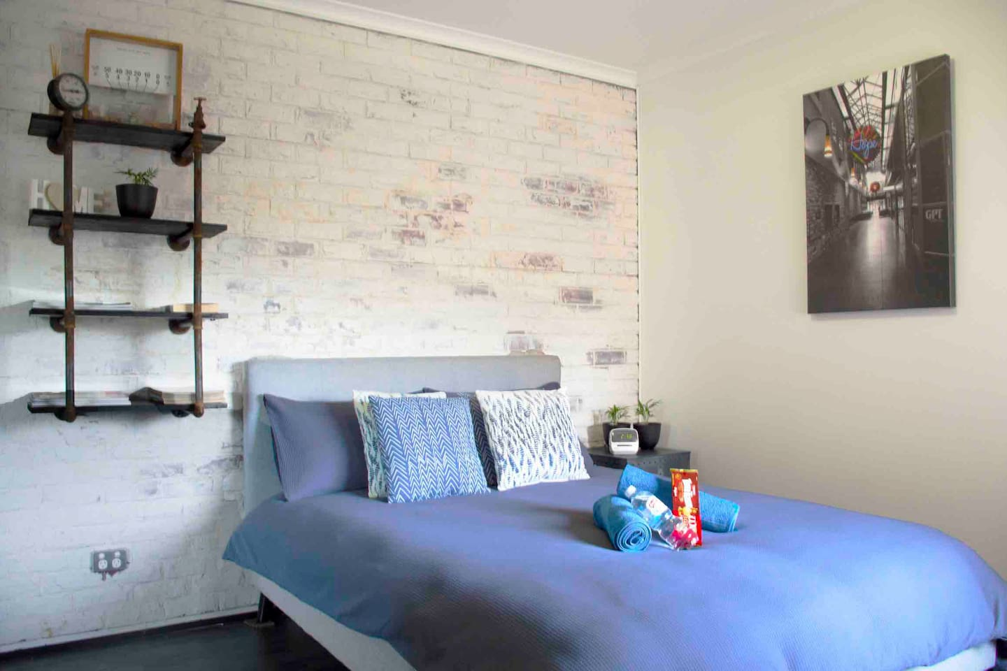 An Industrial inspired room with exposed brick  A comfortable mattress and duck feather pillows will ensure you a have a good sleep