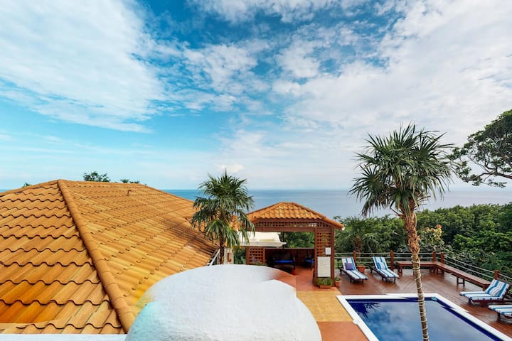Luxury villa w/ sea views, terrace & shared pool - walk to West Bay Beach!