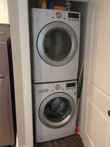 Front loader washer and dryer with detergent provided.