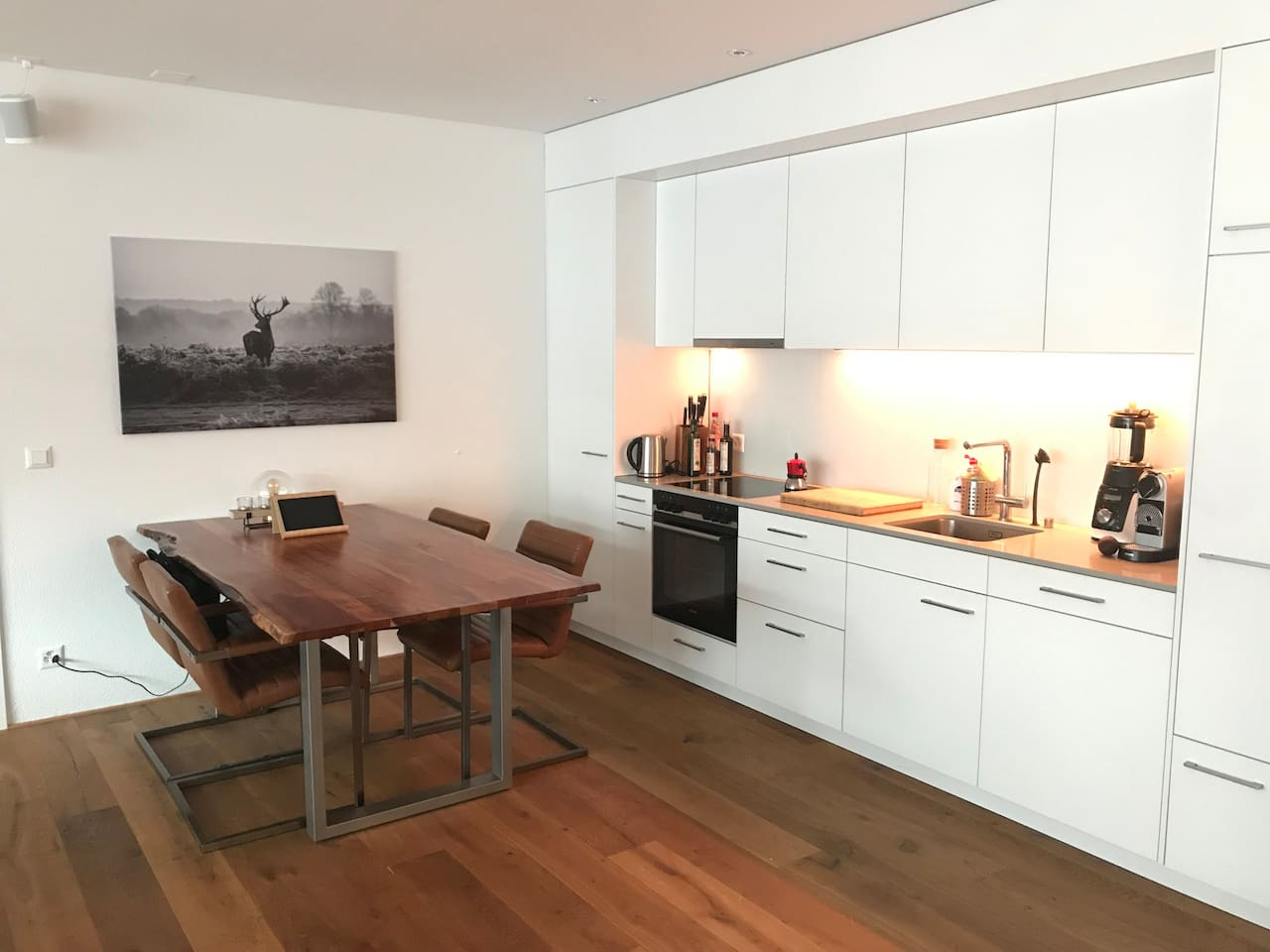 Well equipped Kitchen will ensure great cooking and dining at spacious wooden table with industrial leather chairs makes up for a cheerful evening with friends or family