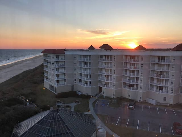 Sunset over building three.