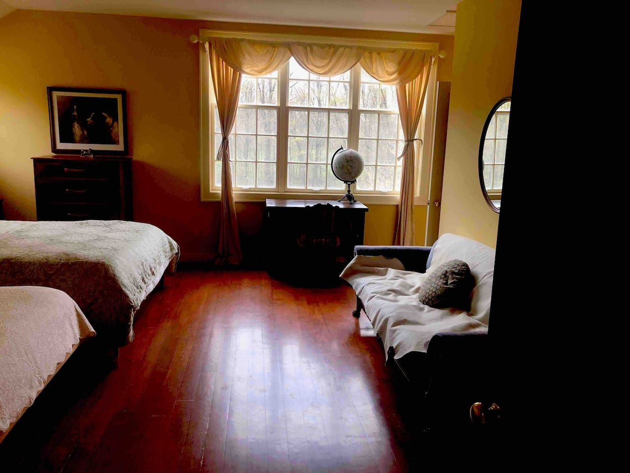 Beautiful cozy room with afternoon light, 2 queen beds, overlooking the horse paddocks.