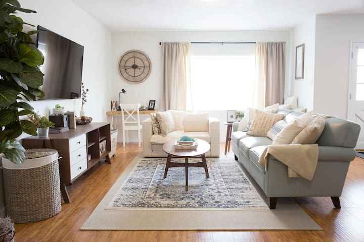 Gather around the warm and inviting living room!