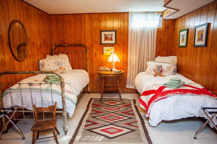 Our darling Cowboy Room with 2 twin beds, on the lower level basement are of the home. Sleeps up to 2