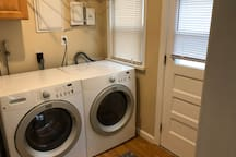 Laundry room off of kitchen has modern washer/dryer