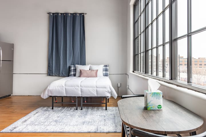 Full size bed with downtown city views. (curtains put in post picture)