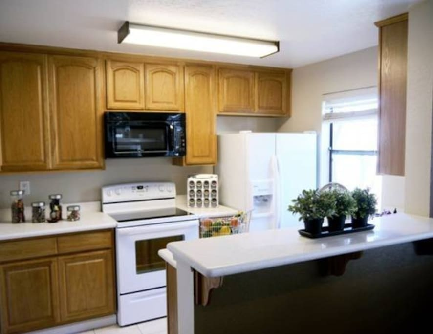 Kitchen with full sets of cookware, dinnerware, utensils, rice cook, coffeemaker and toaster.