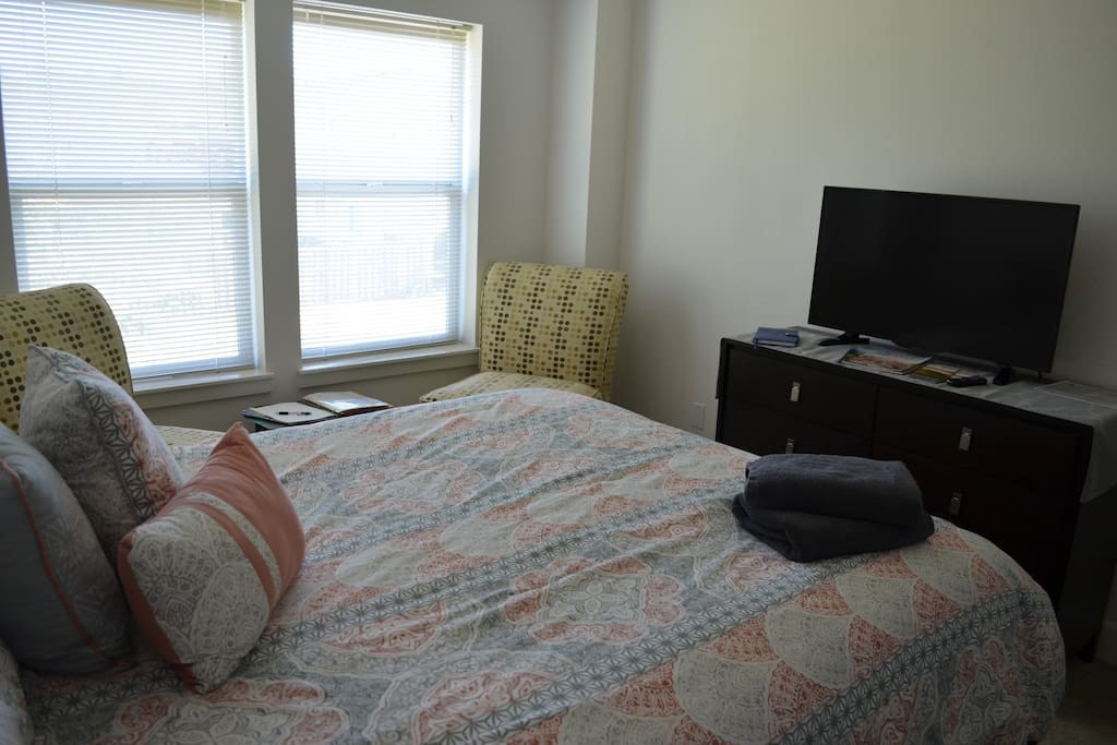 Bedroom 1: The main bedroom includes a SMART TV along with 1 chair for window seating.
