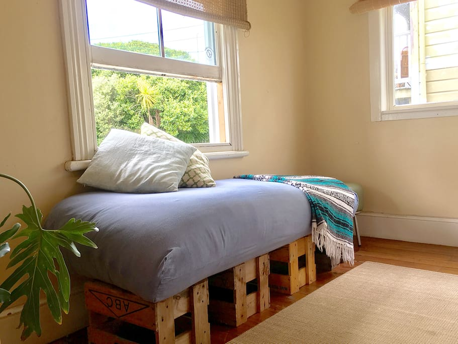 Window seat in the guest bedroom overlooking the leafy street outside