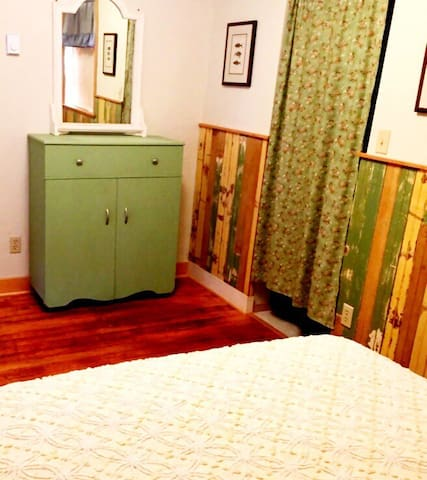 Antique up-cycled wainscotting in the bedroom.