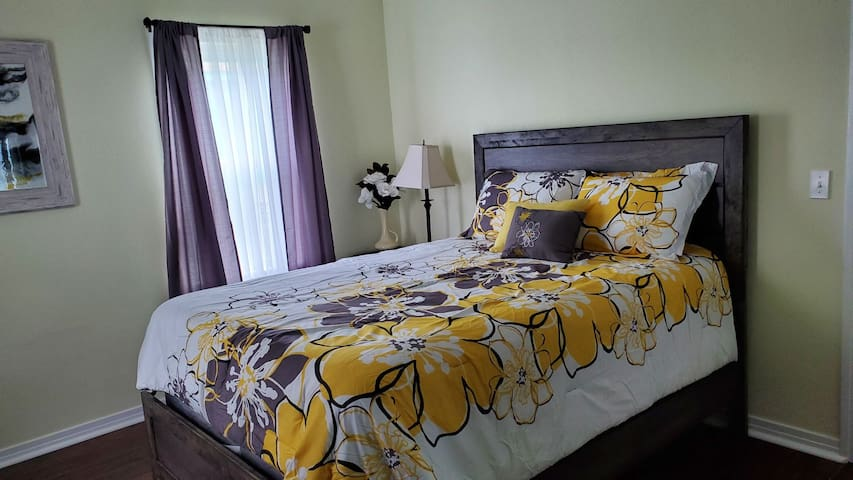"""Queen size bed in the """"Yellow Room"""""""