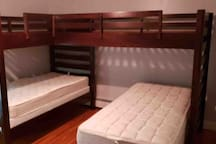 twin size bunk with twin tri-bunk extension and a fourth twin size bed.  all in all there are 4- twin size beds