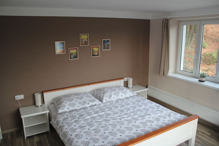 First flat: sleeping room with big bed for two people