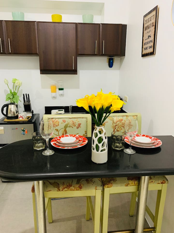 Perfect dining set for two. Refrigerator, microwave and electric kettle are available for use. No cooking wares for short term stay. For long term stay (at least two weeks), cooking wares are available upon request.