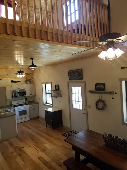 Fully equipped kitchen with dining room and sitting room loft above.