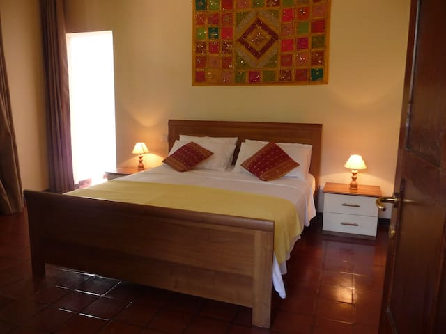 Garden view room with king size bed