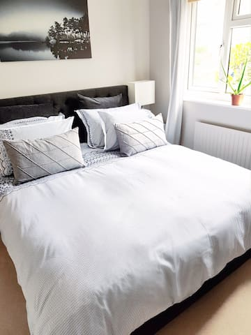 Second bedroom benefits from a modern en-suite bathroom and Super King luxurious bed with high quality linens for a restful night.