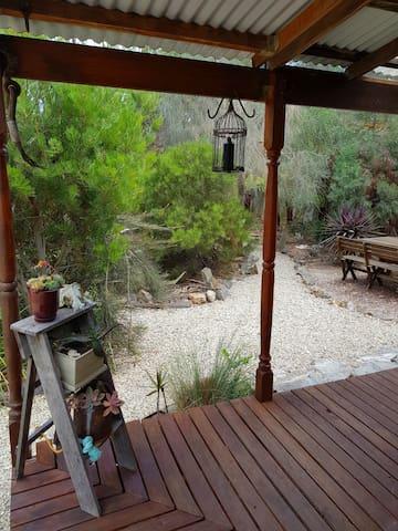 The half wrap around verandah looks out onto native landscaped side garden.
