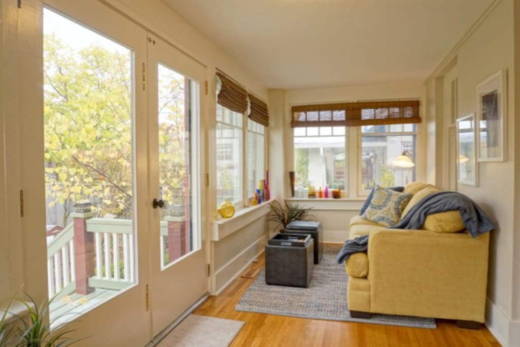 This sunny and bright sunroom is perfect for relaxing!