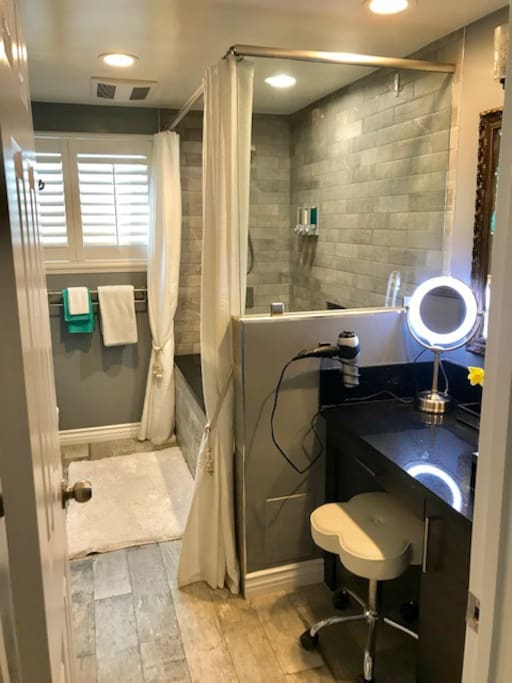 Have a seat while you blow dry or style your hair or apply your makeup at the vanity sink area.