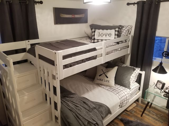 Single top new Bunk Bed with double mattress below, includes lovely new linens.  Professionally decorated for your comfort by TV designer Monique Shaw of Homes Beautifully Design and Staging.