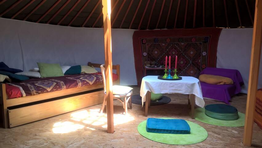 Le lit une personne et une chauffeuse pour un 4ème couchage.