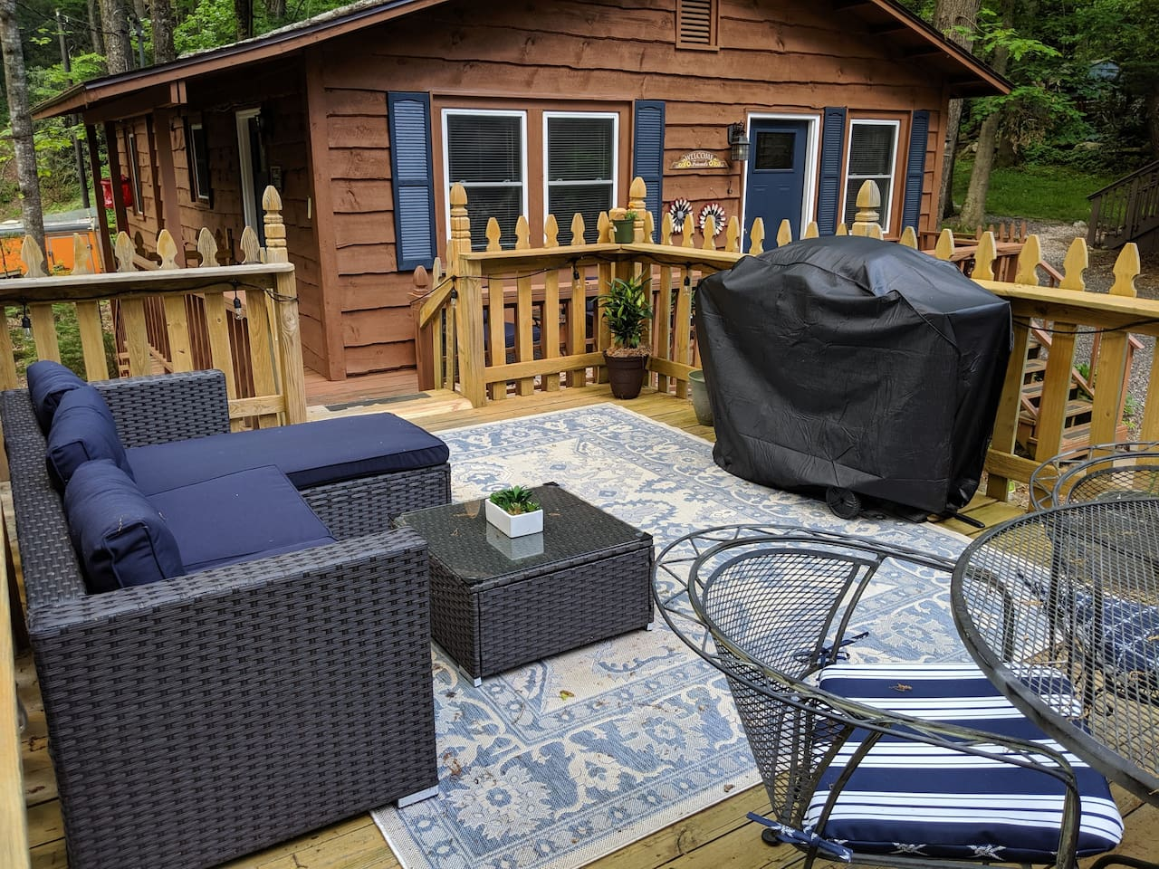 Large outdoor deck with gas grill.